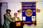 Stourbridge President David Hickman and Sturbridge President Beverly Gray at podium in Sturbridge.  The podium and plaque on the front of the podium were gifts from Stourbridge in 1996.