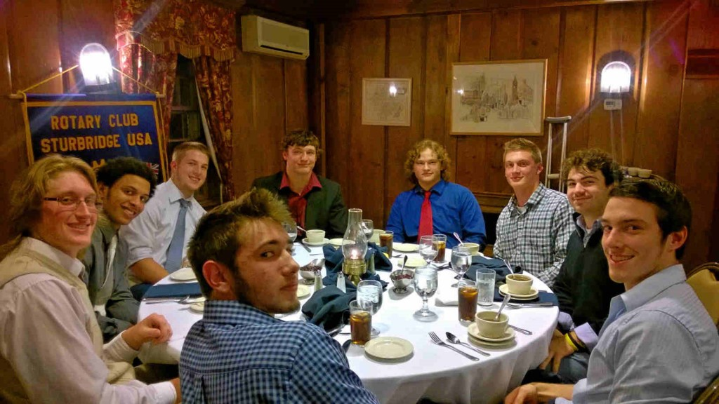 Front Center is (T) Jake Celko, left around table is (T) Zachary Edwards, (SH) Chase Filbbert, (SH) Drew Jean-Guillaume, (SH) Brady Ravenelle, (SH) Chris Lindstrom, (SH) Cam McDonald, (T) Trevor Roberts, (T) Andrew Tichy