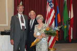 Klaus (left), District Governor Jim Fusco (center), and Glenys (right).