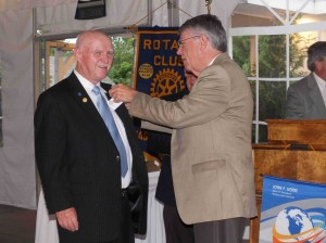 Assistant DG Cliff Gerber pins Austin with his Past President's pin.