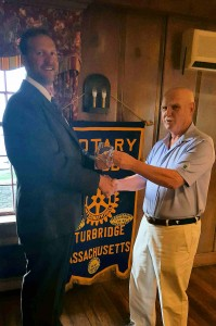 President Austin (right) presents a Rotary mug to Tony.
