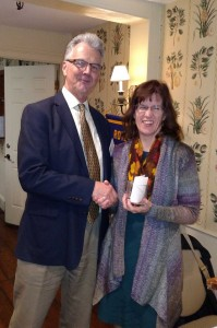 President Otto presents Ann with a Club mug.