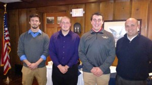 Tantasqua coach Joe Beverage (right) with the team captains.