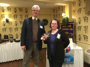 Past President Otto presenting a Rotary mug to Postmaster Jennifer.