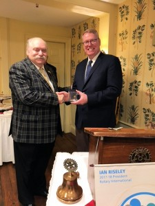 President Dave presents Jim with a Rotary mug.