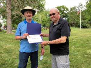 Carl (L) presented Fran with a Paul Harris Fellow designation.