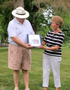 Pauline presenting Dave with the President's Book for his year.